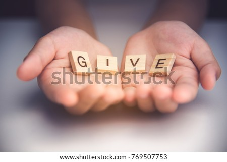"""The word """"GIVE"""" in hands in cupped shape. Concepts of sharing, giving,  Royalty-Free Stock Photo #769507753"""
