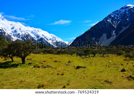The snow mountain range of Aoraki mount Cook at the beginning of Hooker valley tracking in south island, New zealand. #769524319