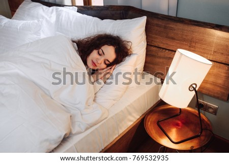Beautiful young girl sleeping in the bedroom. #769532935