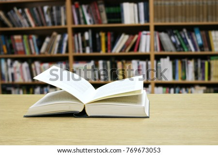Open book on the table #769673053