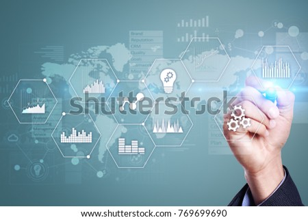 Applications icons and graphs on virtual screen. Business, internet and technology concept. #769699690