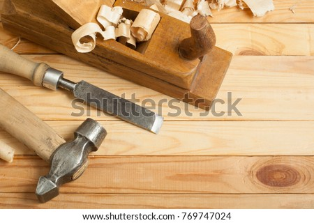 Carpentry concept.Joiner carpenter workplace. Construction tools on wooden table with sawdust. #769747024