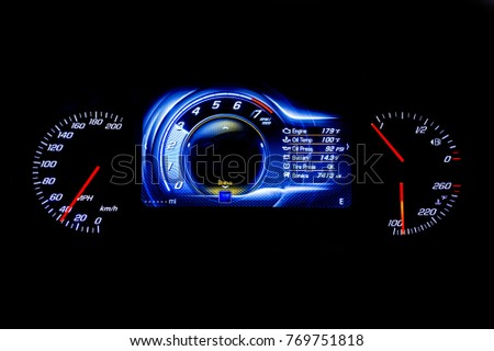 Modern light car mileage (dashboard, milage) isolated on a black background. New display of a modern car. MPH, fuel and temperature (Fahrenheit) digital indicators. Engine, Oil temp, Oil, Battery. #769751818