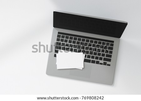 3d rendering : illustration of white name card or debit card, credit card, or paper put on keyboard of grey laptop. shopping online concept. #769808242