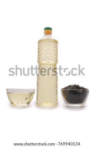 Bottle of sunflower oil isolated on white background with soft shadow. Clipping path #769940134