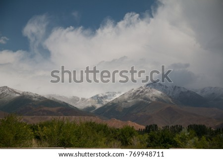 Mountains at Issyk kul lake, Kyrgyzstan, Central Asia #769948711