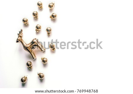 Christmas composition with a deer and Christmas balls on a white background. Christmas background for presentation of work or text. Beautiful greeting card.Top view. Copy space #769948768