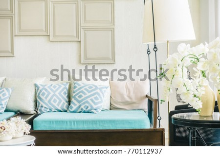 Comfortable pillow on sofa decoration of living room interior #770112937
