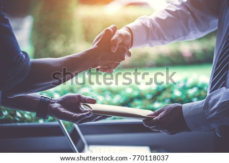 Investors get money from investors in the insurance business with the bank, businessman get money concept, bank customers come to negotiate a loan to invest. Royalty-Free Stock Photo #770118037