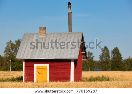 Traditional finnish red wooden farm in the countryside. Finland  #770159287