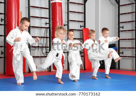 Little children practicing karate in dojo Royalty-Free Stock Photo #770173162