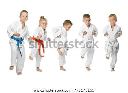 Little children practicing karate on white background #770173165