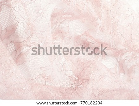 Texture lace fabric. lace on white background studio. thin fabric made of yarn or thread. typically one of cotton or silk, made by looping, twisting, or knitting thread in patterns #770182204