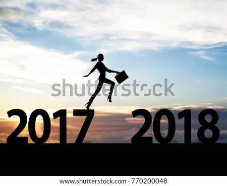 Men jump over silhouette Happy New Year 2018 #770200048