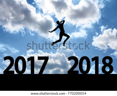 Men jump over silhouette Happy New Year 2018 #770200054