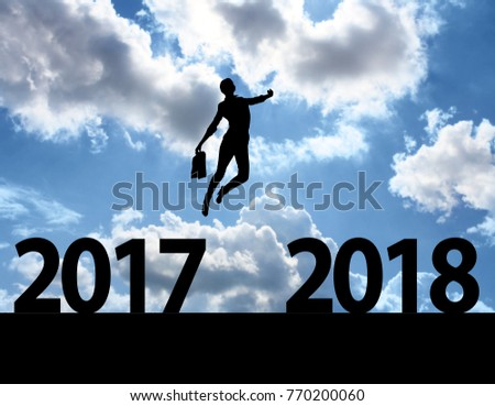 Men jump over silhouette Happy New Year 2018 #770200060