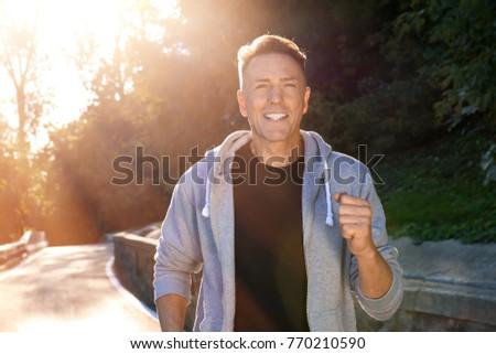 Mature sporty man running outdoors #770210590