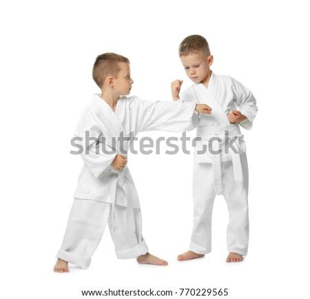 Little children practicing karate on white background #770229565