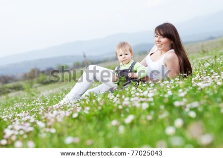 Young mother with child outside on a summer day #77025043