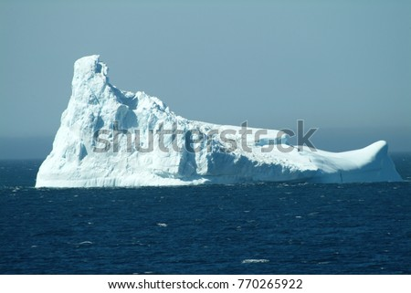 Thousands of icebergs are formed off the coast of Greenland. They drift into the shipping lanes and in the past they caused the destruction of the Titanic with great loss of life. Beauty and tragedy. Royalty-Free Stock Photo #770265922