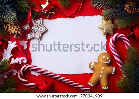 Christmas greeting card; christmas tree decoration on red background