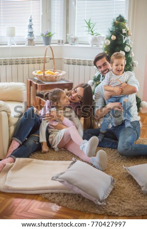 Cheerful Family Playing - Happy Family, Christmas fun #770427997