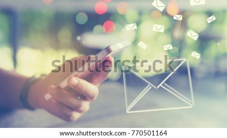 woman hand using smart phone double exposure with email flying and colorful bokeh light abstract background. technology and business concept. vintage tone color style #770501164