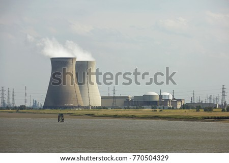 Smoke rising from industrial chimney in energetic factory. #770504329