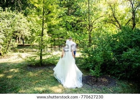 Couple walcing in the landskape #770627230