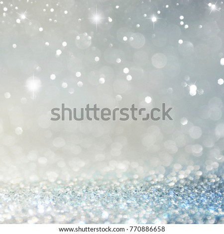 Christmas light background.  Holiday glowing backdrop. Defocused Background With Blinking Stars. Blurred Bokeh. #770886658