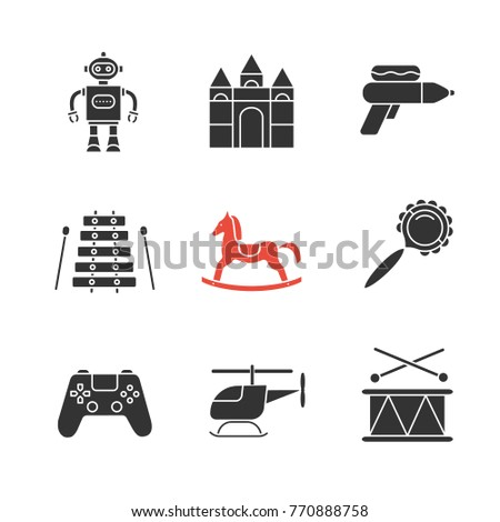 Kids toys glyph icons set. Robot, castle blocks, water gun, xylophone, rocking horse, rattle, gamepad, helicopter, drum. Silhouette symbols. Raster isolated illustration