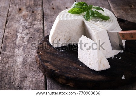 A fresh ricotta with basil leaf on wooden table italian food concept #770903836