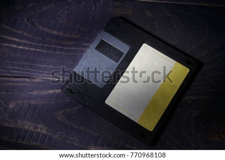 Floppy disk on a wooden table