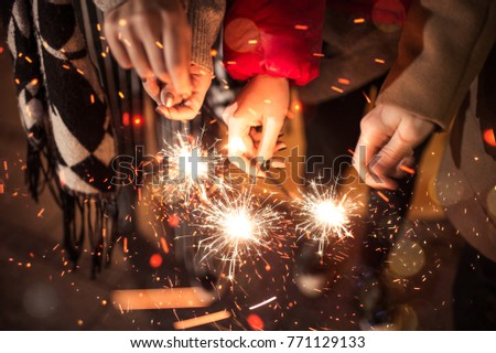 Friends celebrating with sparklers #771129133