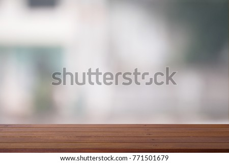 Wooden desk with Abstract blurred outdoor for background. #771501679