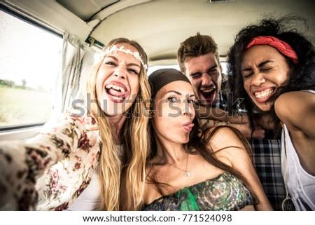 Hippie friends driving on a minivan #771524098