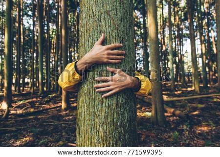 Man hugging tree bark #771599395