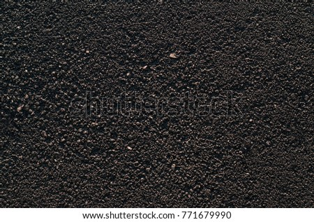 Gray asphalt texture, road pattern background, dark tone, stone pattern, seamless texture, filling in