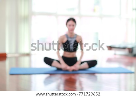 blurred image of young healthy and sporty woman do yoga stretching in gym using as fitness and workout background concept  #771729652