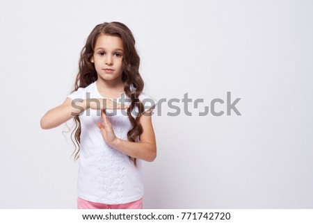 Little girl. Stop gesture. White background. #771742720