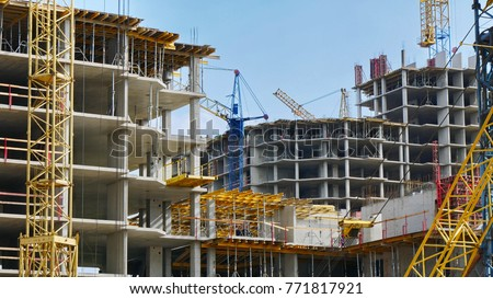 Construction site background. Hoisting cranes and new multi-storey buildings. I.ndustrial background. Royalty-Free Stock Photo #771817921