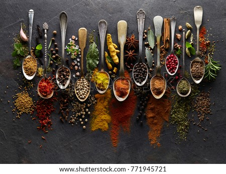 Herbs and spices on graphite background #771945721