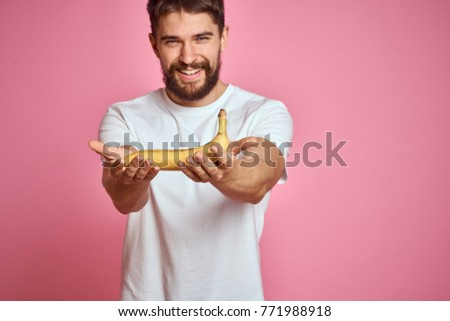man smiling in his hand banana on a pink background, logo, fruit, vitamins                               #771988918