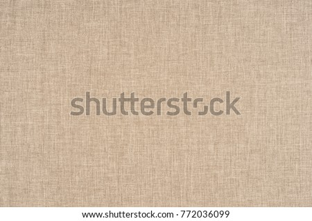 close up of a woolen fabric of beige color. Abstract background, empty template. #772036099