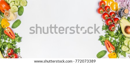 Healthy clean eating layout, vegetarian food and diet nutrition concept. Various fresh vegetables ingredients for salad on white table background, top view, frame, banner Royalty-Free Stock Photo #772073389
