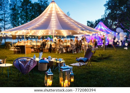 Colorful wedding tents at night. Wedding day. #772080394