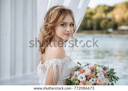 Beautiful bride with wedding flowers bouquet, attractive woman in wedding dress. Happy newlywed woman. Bride with wedding makeup and hairstyle. Smiling bride. Wedding day. Gorgeous bride. Marriage. #772086673