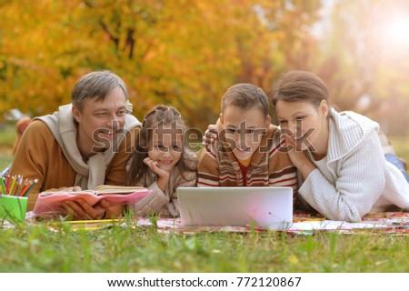 parents and children doing homework  #772120867
