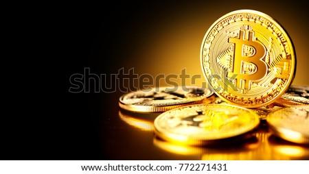 Bitcoin. Crypto currency Gold Bitcoin, BTC, Bit Coin. Macro shot of Bitcoin coins isolated on black background Blockchain technology, bitcoin mining concept. #772271431