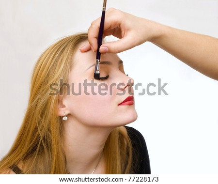a young girl remedies a make-up #77228173